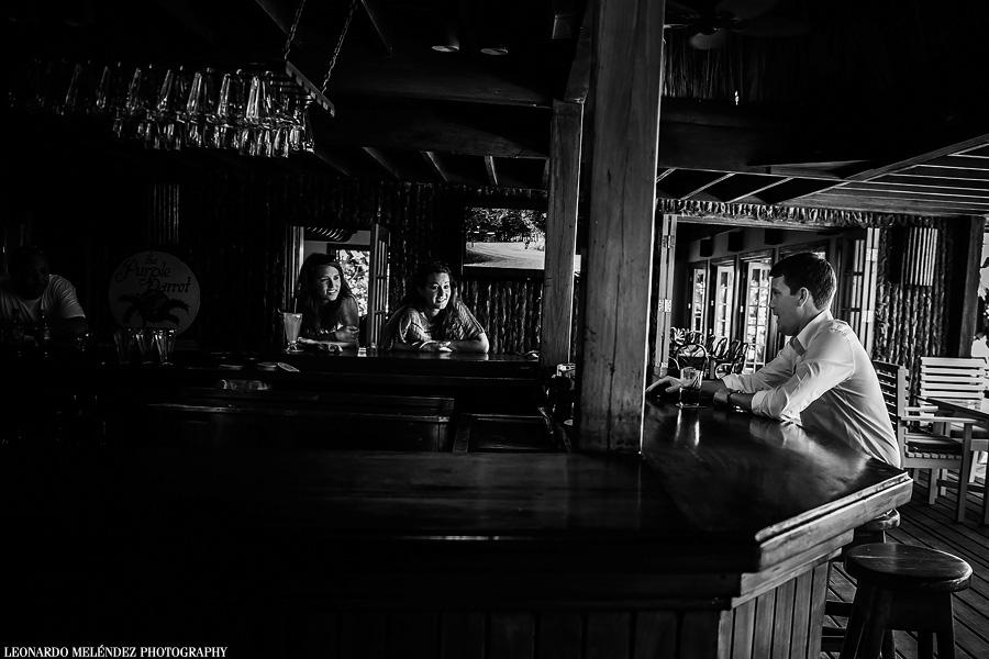 Groom at the bar. Belize wedding at Ramon's Village. Belize wedding photography by Leonardo Melendez.