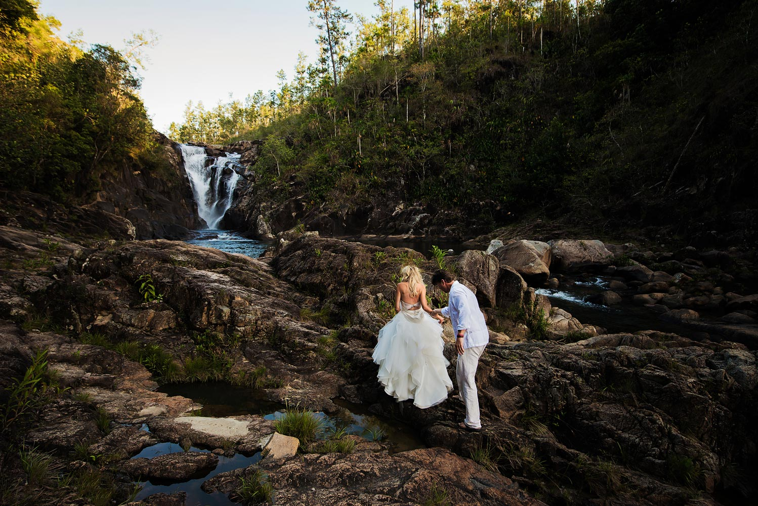Waterfall trash the dress in Belize.  Belize wedding photographers, Leonardo Melendez Photography.