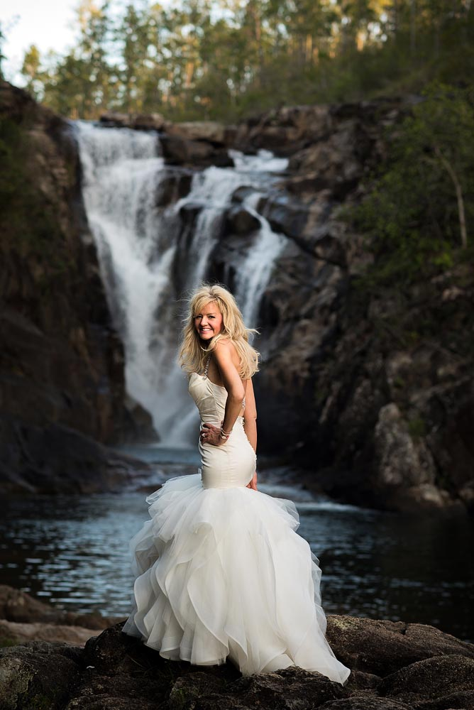 Trashing the dress off a waterfall in Belize.  Image by Belize wedding photographers, Leonardo Melendez Photography.