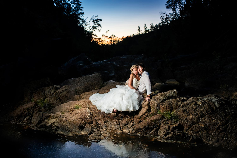 Waterfall trash the dress in Belize.  Belize wedding photographers, Leonardo Melendez Photography.